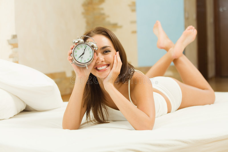Download Woman with alarm-clock stock photo. Image of interior - 8567006