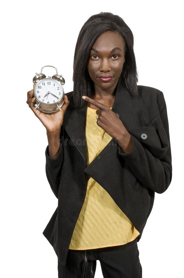 Woman with alarm clock stock image