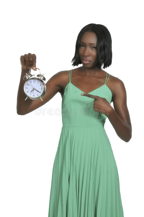Woman with alarm clock stock images