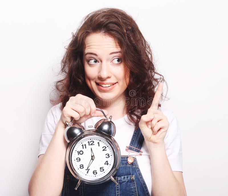 Woman with alarmclock stock photography