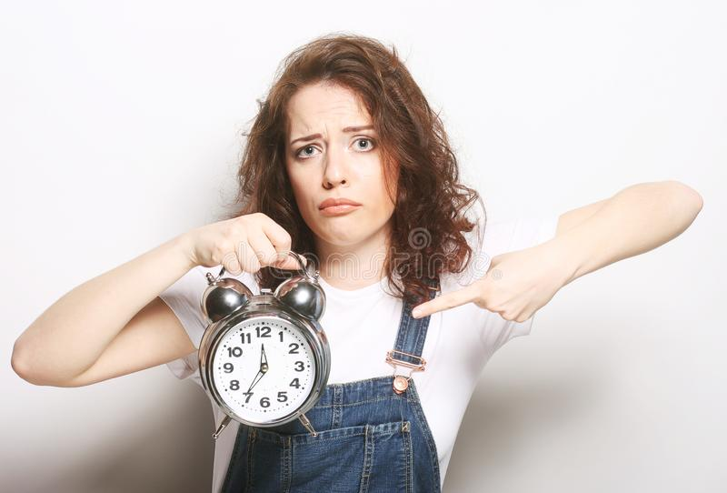 Woman with alarmclock. Young fun woman with alarmclock royalty free stock image
