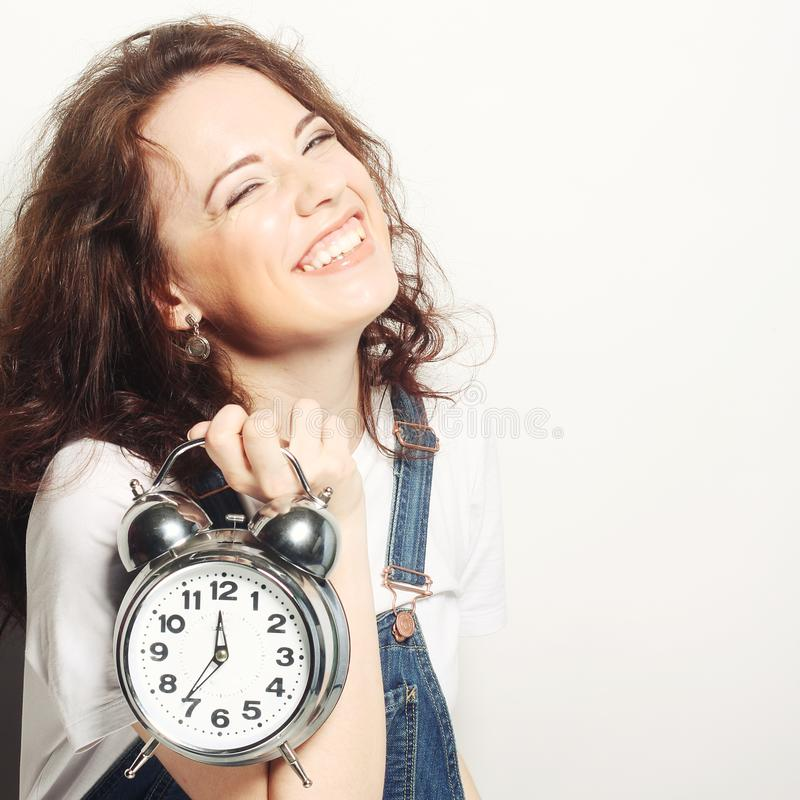 Woman with alarmclock stock images