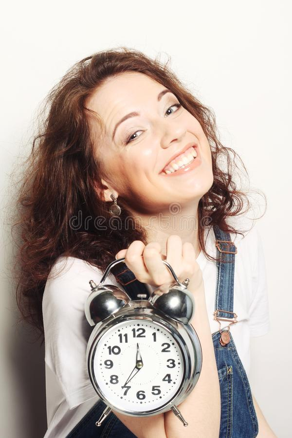 Woman with alarmclock royalty free stock photo