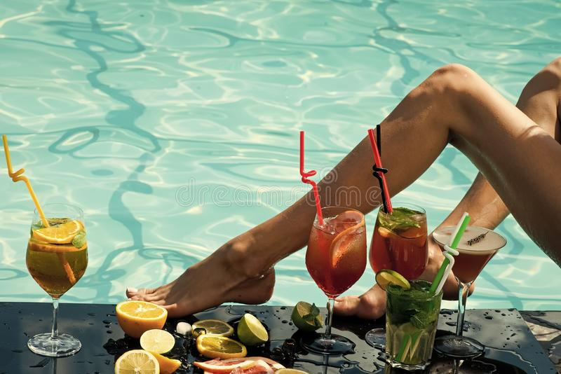 Woman with alcoholic beverage and fruit. stock images