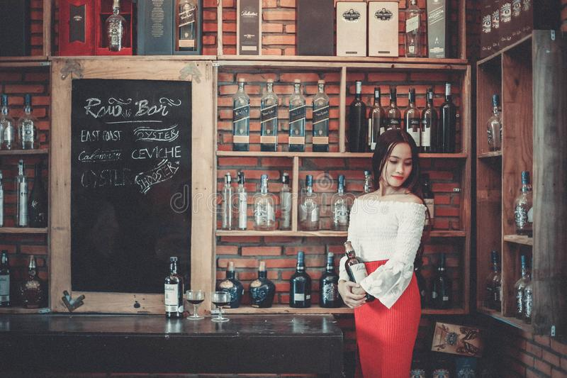 Woman with Alcoholic Beverages royalty free stock image