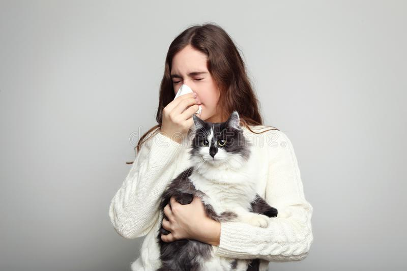 Woman with allergy holding cat stock photos