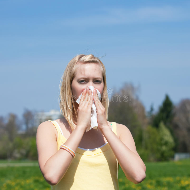Woman with allergy sneezing royalty free stock photo