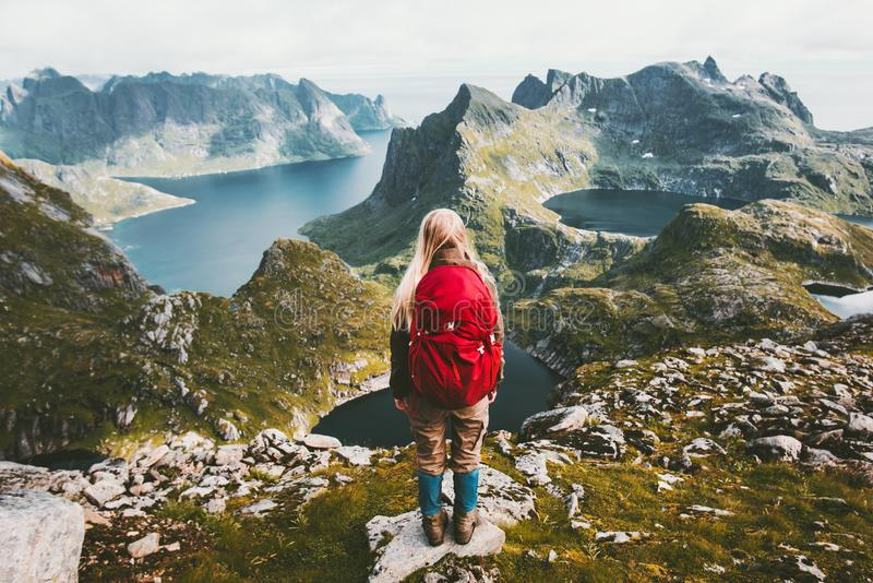 Woman alone with backpack exploring mountains of Norway stock images