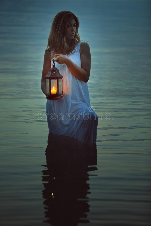 Woman alone in dark waters royalty free stock photo