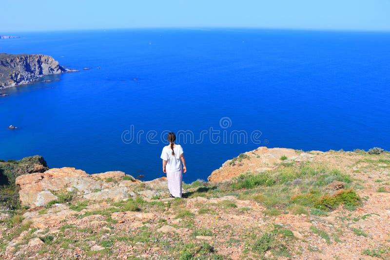 Woman alone facing the Mediterranean Sea, France stock photos