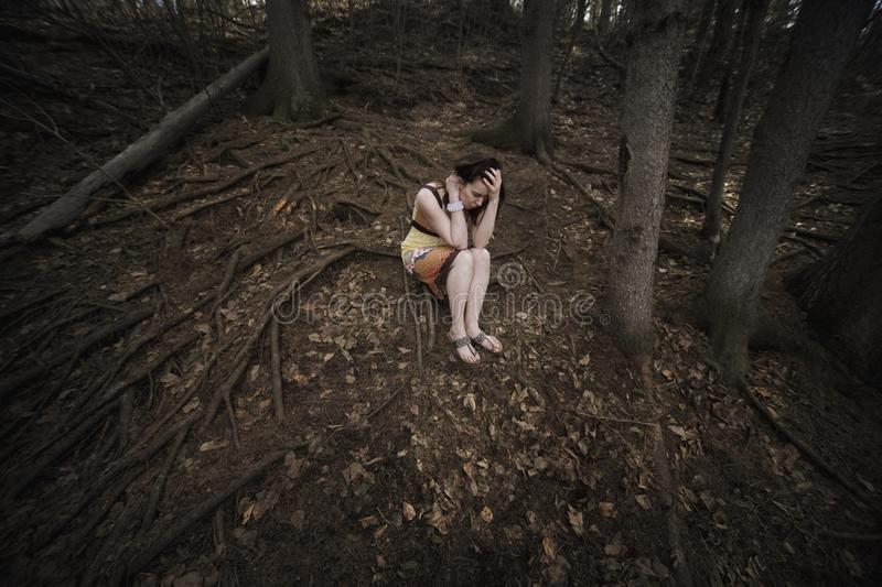 Download Woman Alone In The Forest stock image. Image of posed - 17064261