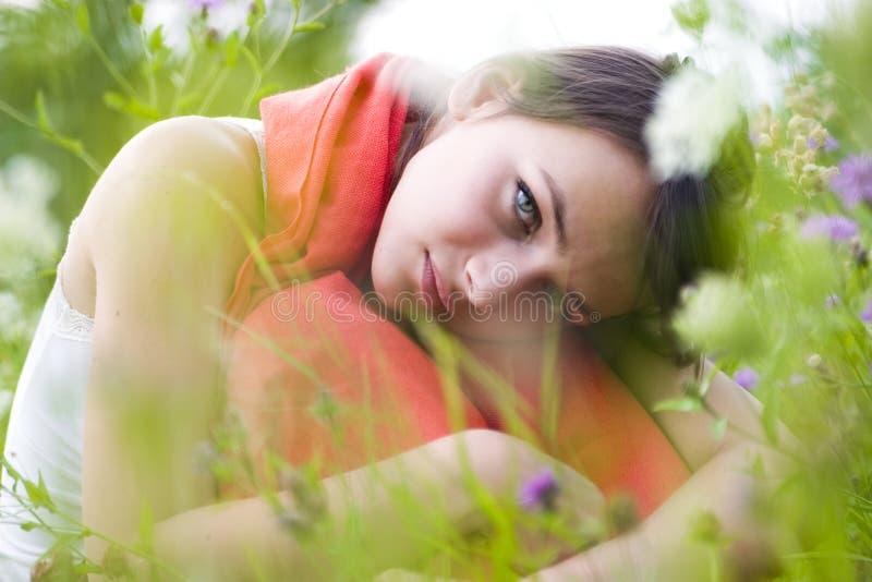 Woman amongst wildflowers stock image