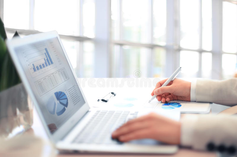 Woman Analysis Business Accounting. On Laptop