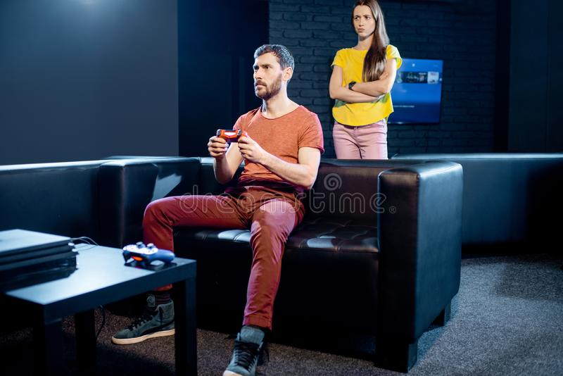 Woman angry at her boyfriend playing video games royalty free stock photography
