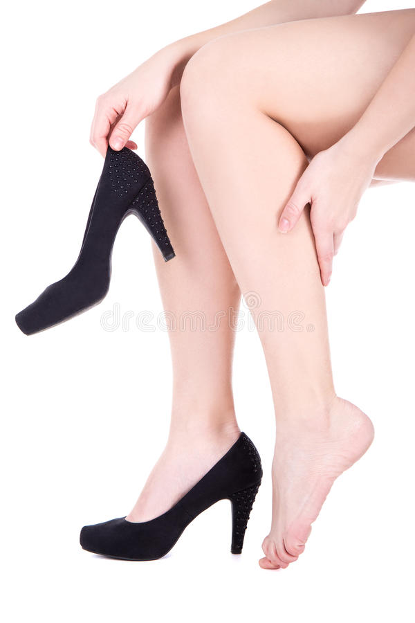 Woman with ankle pain or callus isolated on white royalty free stock image