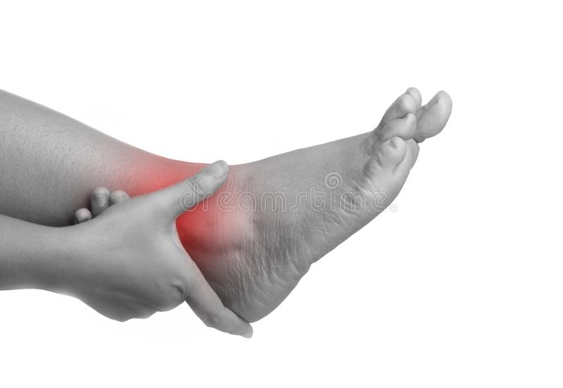 Woman with ankle pain using hand holding leg and massaging painful her royalty free stock photos