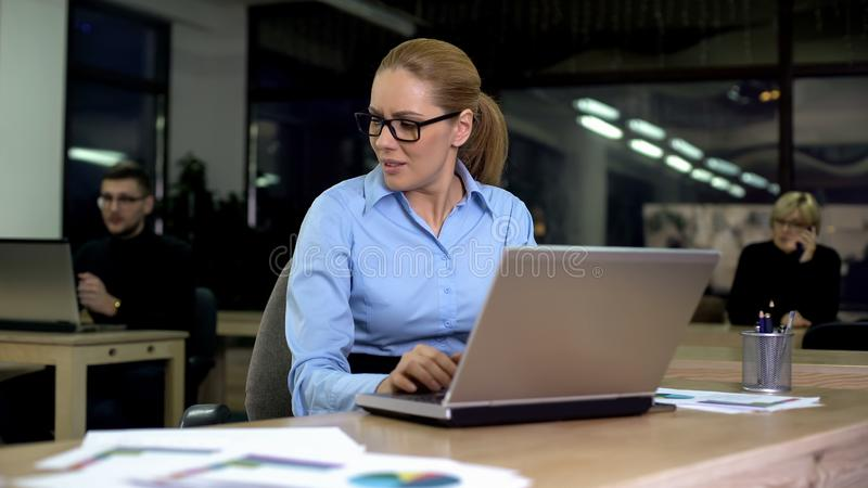 Woman annoyed with noisy colleagues, poor working conditions, stressful job royalty free stock image