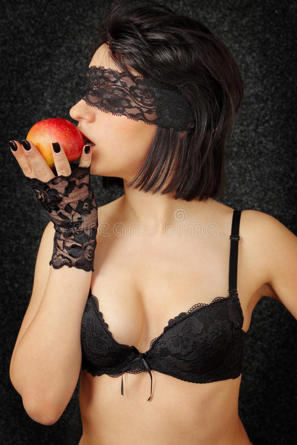 Woman with the apple royalty free stock photos