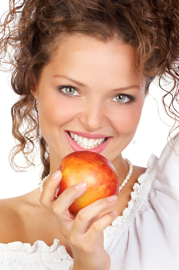 Woman with apple royalty free stock photography