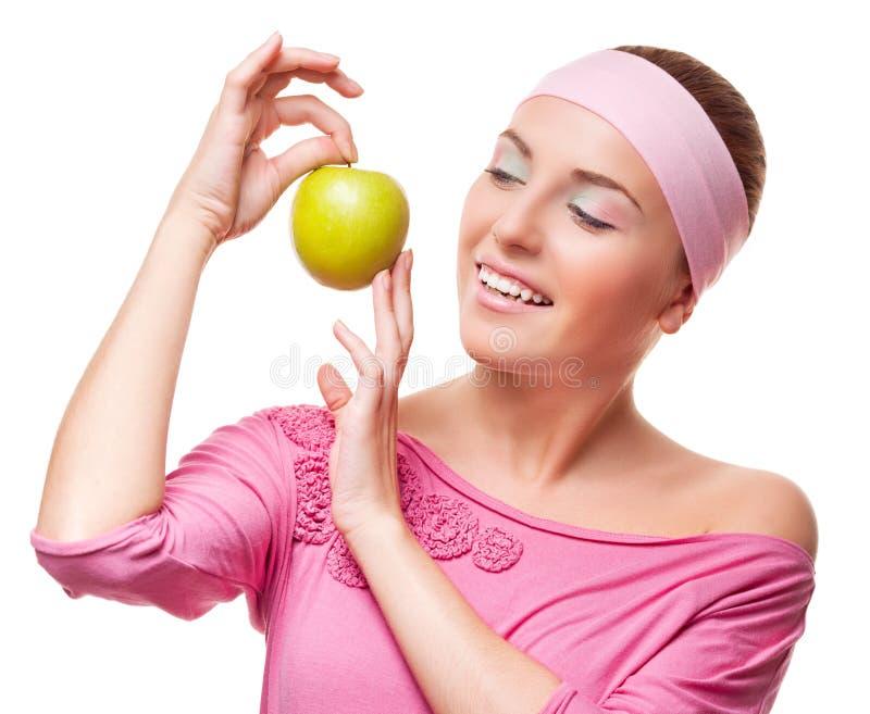 Woman with an apple stock photos