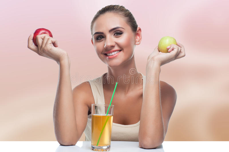 Woman with apple juice on autmn color background stock photography