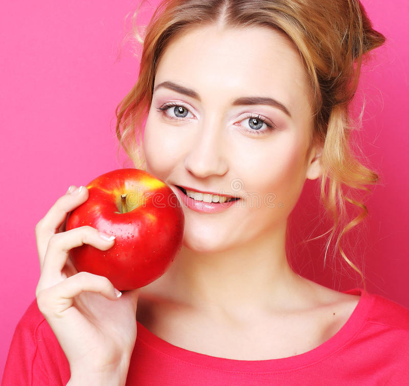 Download Woman With Apple Over Pink Background Stock Photo - Image of lady, bright: 39509242