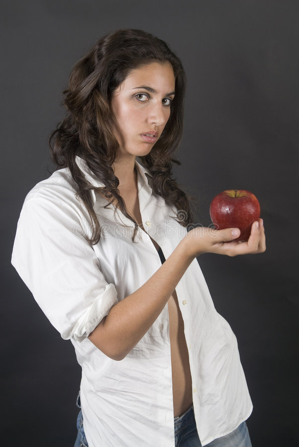 Download Woman With Apple In A Temptation Stock Photo - Image: 7002346