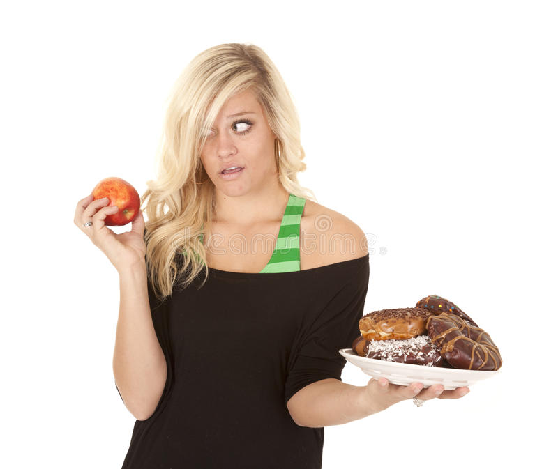 Download Woman With Apple Want Donut Royalty Free Stock Photo - Image: 22132125