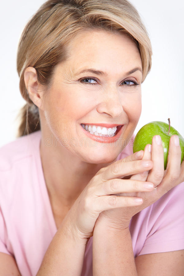 Woman with apples. Mature smiling woman with apple stock images