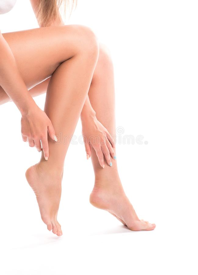 Woman apply cream on her bare feet. stock images
