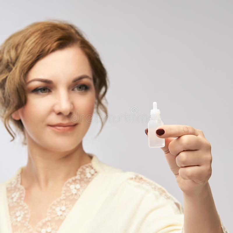 Woman apply eye drops. Girl glaucoma treatment stock images