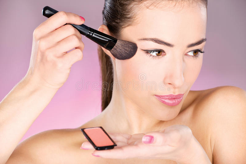 Download Woman Applying Cosmetic Powder Brush Stock Photo - Image: 22549346