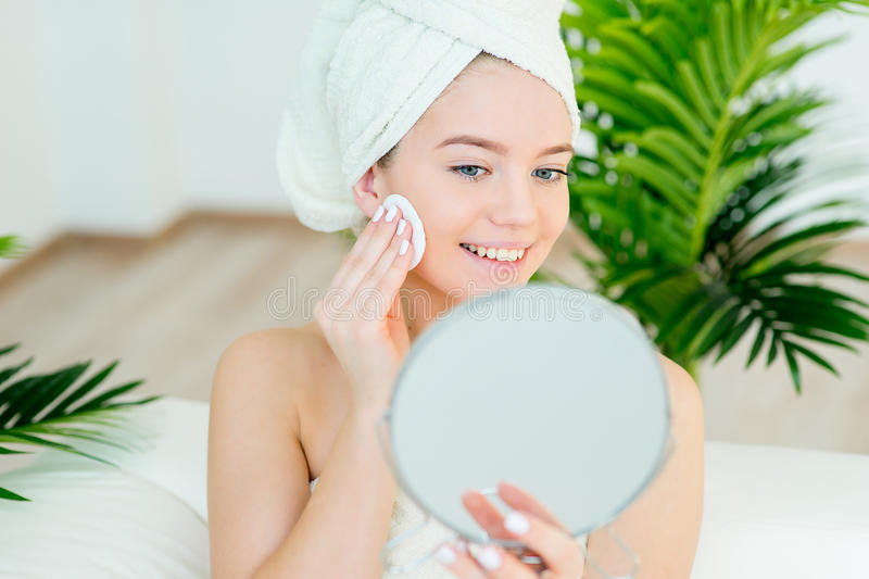 Woman applying a cream royalty free stock image