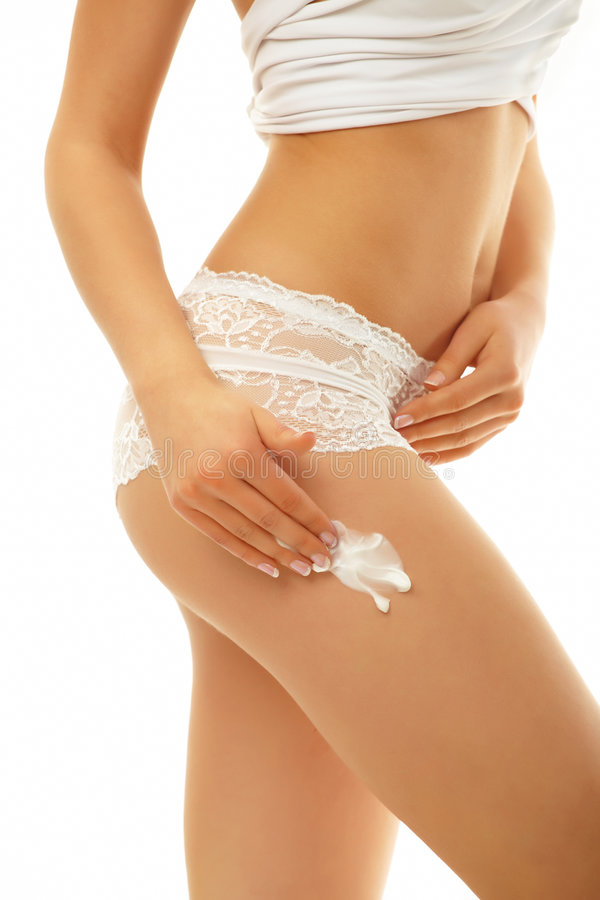 Free Woman Applying Cream On Her Body Stock Photos - 8963383