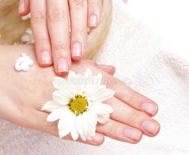 Woman applying cream to her hands royalty free stock photo
