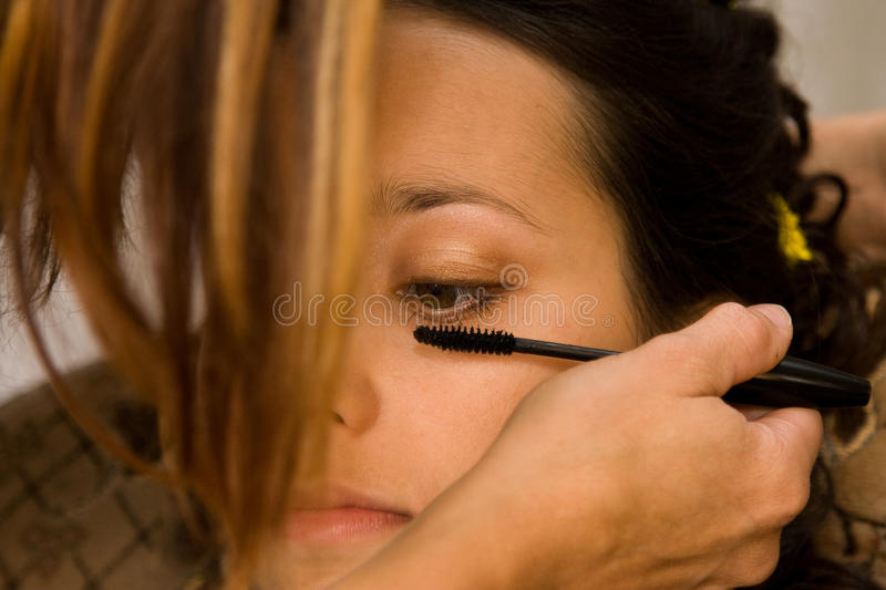 Download Woman applying eye makeup stock image. Image of back - 11810507