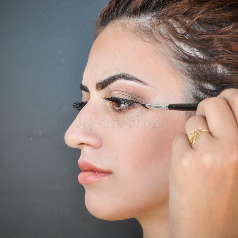 Woman Applying Eyeshadow On Her Eyes Stock Photo Image