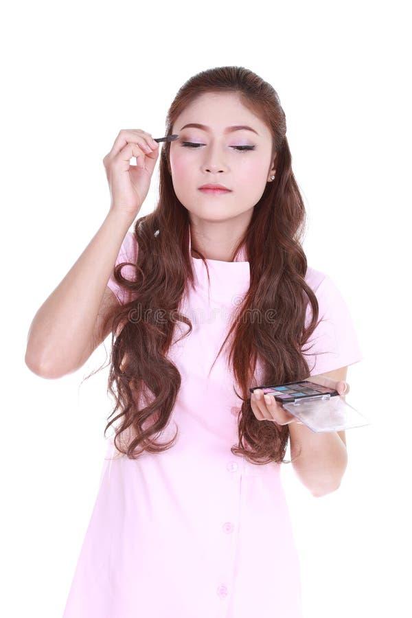 Woman applying eyeshadow powder royalty free stock photo