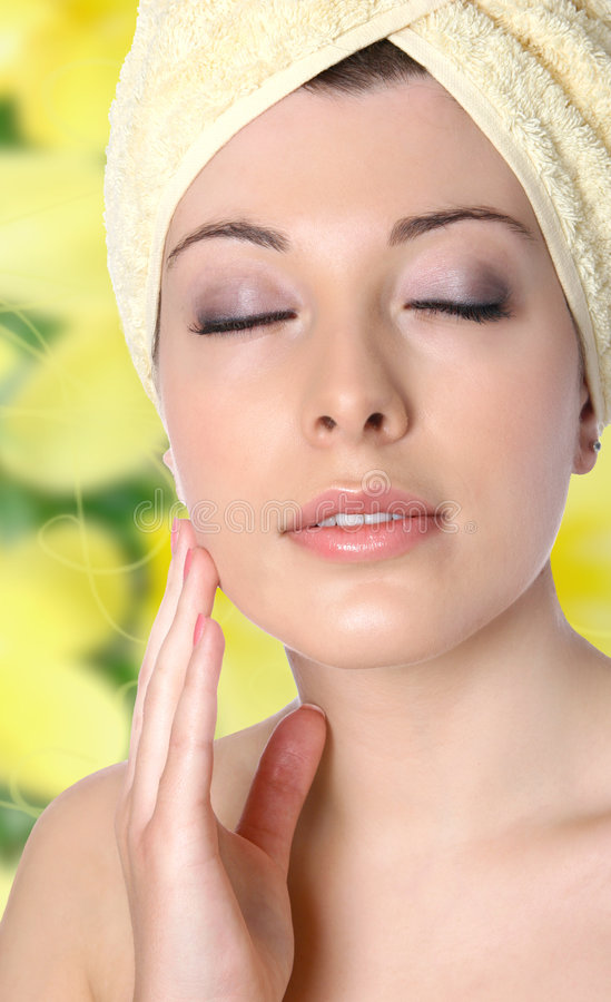Woman applying face cream royalty free stock photo