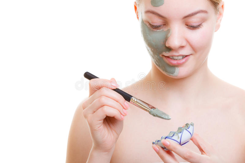Woman applying face mask with brush royalty free stock image