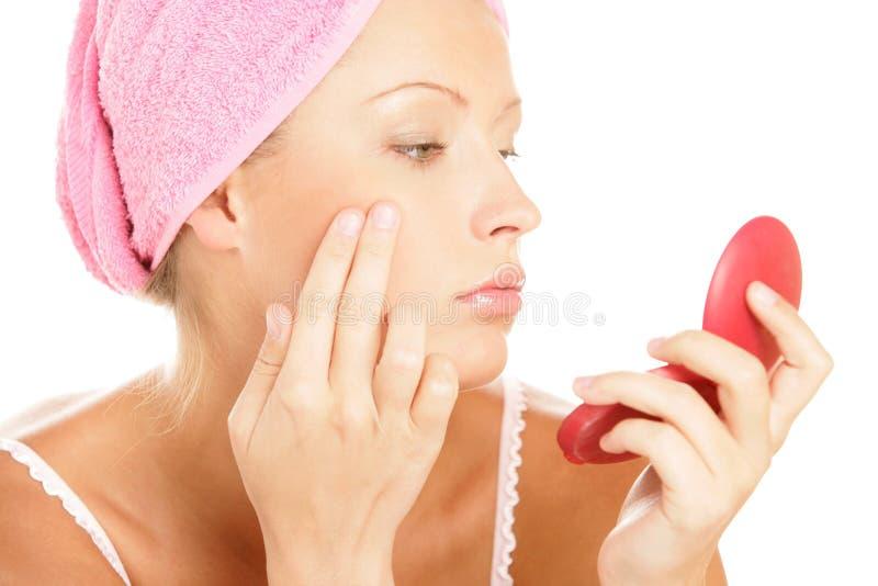 Download Woman Applying Facial Cream Stock Photo - Image: 11447118