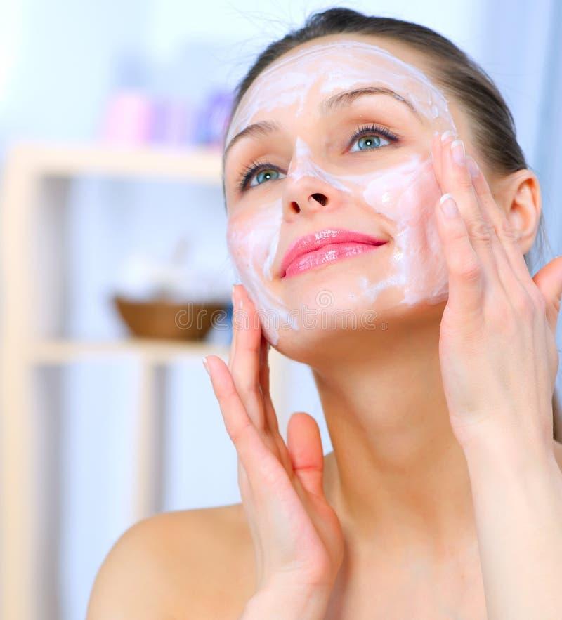 Woman Applying Facial Mask royalty free stock image