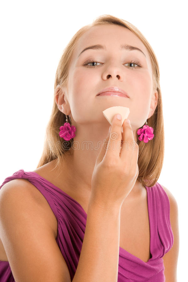 Woman applying foundation royalty free stock images