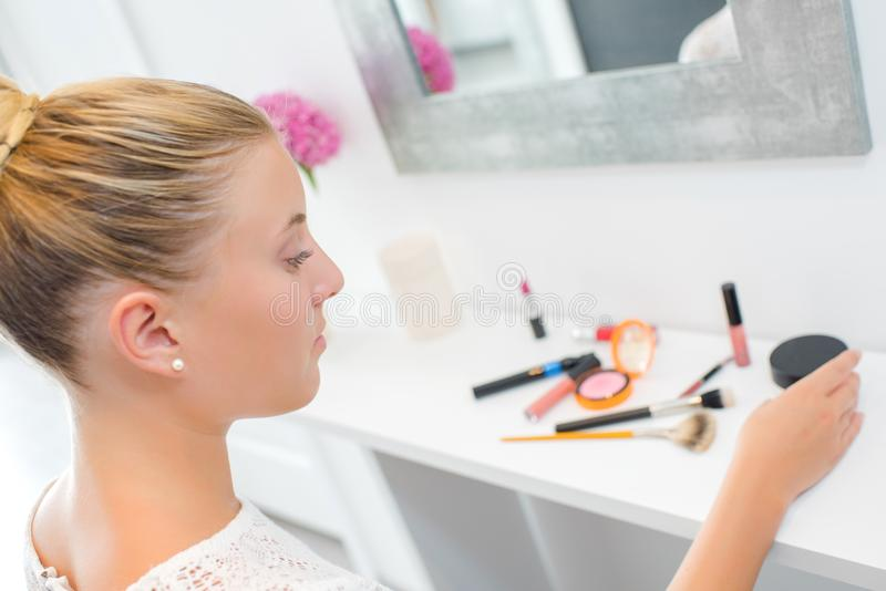 Woman applying lip gloss. Accessory royalty free stock images