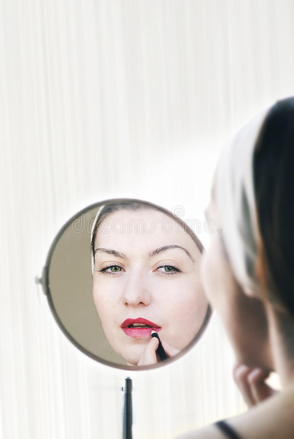 Download Woman applying lip stick stock photo. Image of cosmetics - 23444088