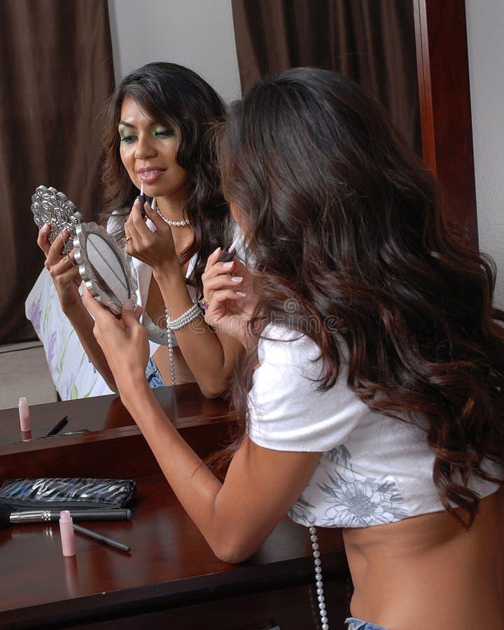 Download Woman applying lipstick stock photo. Image of makeup, applying - 3023130
