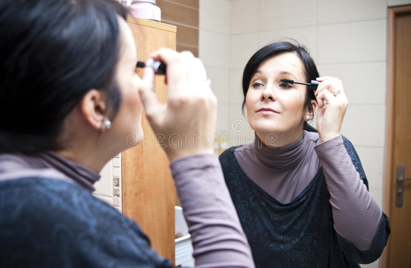 Download Woman applying make up stock photo. Image of adult, middle - 11998254