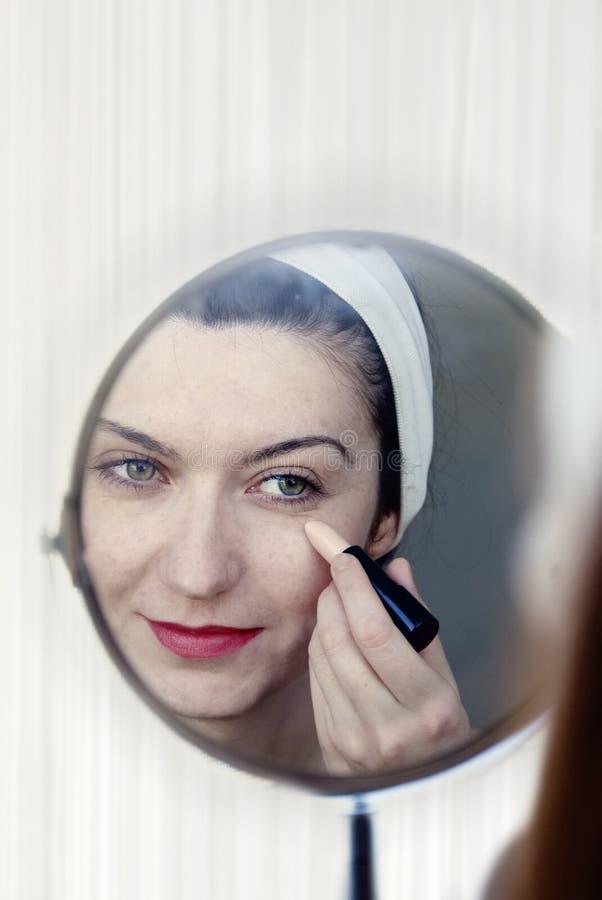 Download Woman applying make up stock image. Image of interior - 23444109