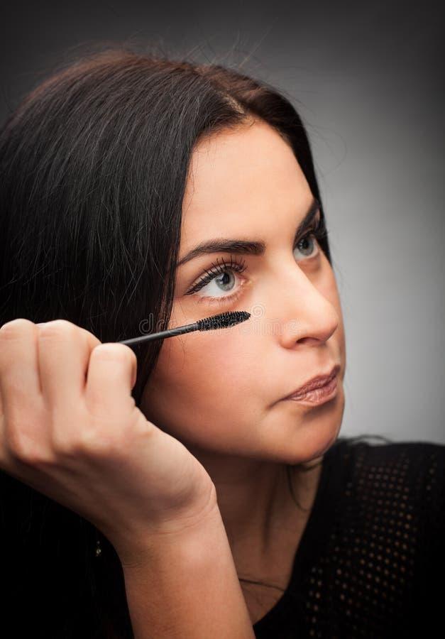 Download Woman applying mascara stock photo. Image of beauty, hands - 28789204