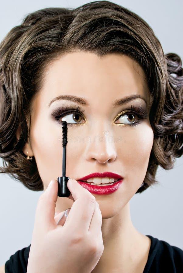 Download Woman Applying Mascara On Her Eyelashes Stock Image - Image: 25530173